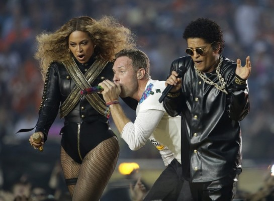 Photo: Beyoncé, Coldplay singer Chris Martin and Bruno Mars perform during halftime of the NFL Super Bowl 50 football game on Sunday, Feb. 7, 2016, in Santa Clara, Calif./ Julio Cortez/AP/Press Association Images.