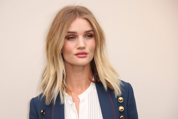Model Rosie Huntington-Whiteley poses for photographers upon arrival at the Autumn Winter 2016 Burberry Prorsum show in London, Monday, Feb. 22, 2016. (Photo by Joel Ryan/Invision/AP)