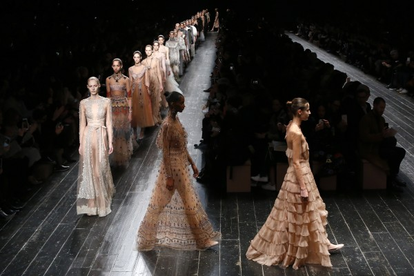 Models wear creations as part of Valentino's Fall-winter 2016-2017 ready to wear collection presented in Paris, France, Tuesday, March 8, 2016. (AP Photo/Francois Mori)