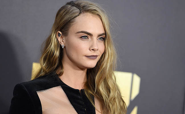 Cara Delevingne arrives at the MTV Movie Awards at Warner Bros. Studios on Saturday, April 9, 2016, in Burbank, Calif./Picture by: Jordan Strauss / Invision/Press Association Images.