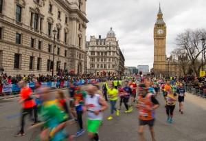 Runner pass through Parliament Square during the 2016 Virgin Money London Marathon.