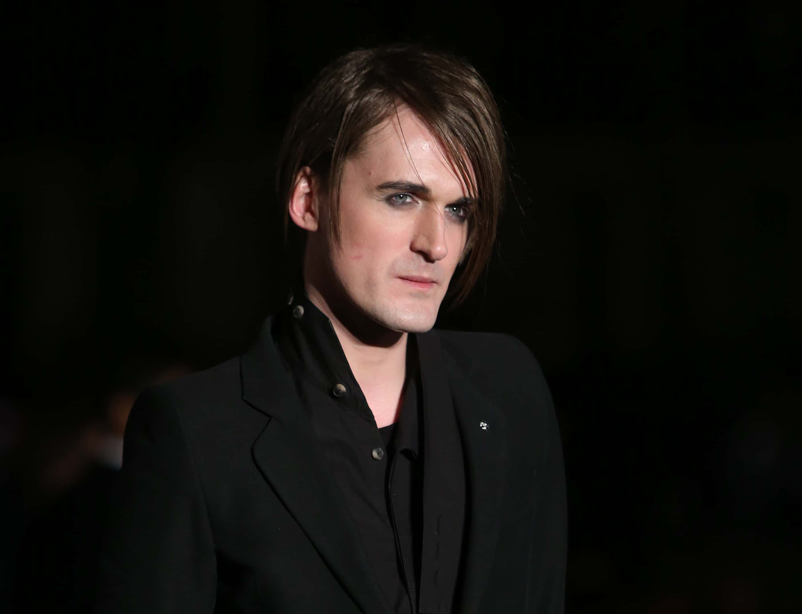 Gareth Pugh poses for photographers upon arrival at the Alexander McQueen Savage Beauty Gala exhibition in London, Thursday, March 12, 2015. (Photo by Joel Ryan/Invision/AP)